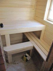 Строительство стеллажа,  подиума,  полок,  шкафчика из доски на даче.